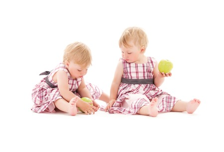 picture of two adorable twins over white Stock Photo - 5668783