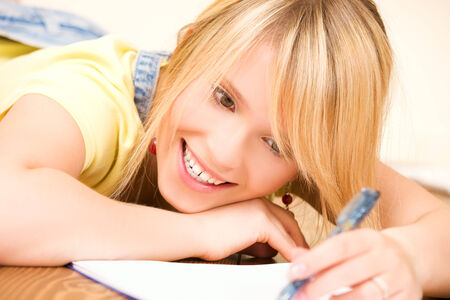 picture of teenage girl with notebook and pen Stock Photo - 5668611