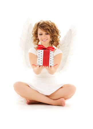 picture of happy teenage angel girl with gift over white Stock Photo - 5668819