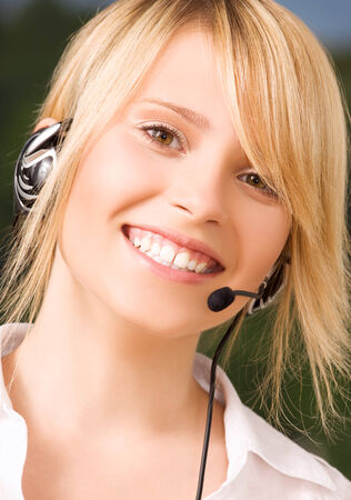 bright picture of friendly female helpline operator Stock Photo - 5685312