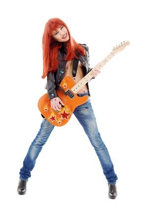 pelirrojas: Fotografía de una niña pelirroja encantadora con la guitarra de color naranja
