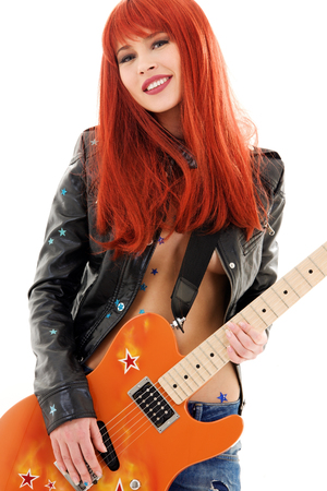picture of lovely redhead girl with orange guitar Stock Photo - 5685253