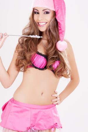 sexy santa helper girl with magic wand Stock Photo - 5685364