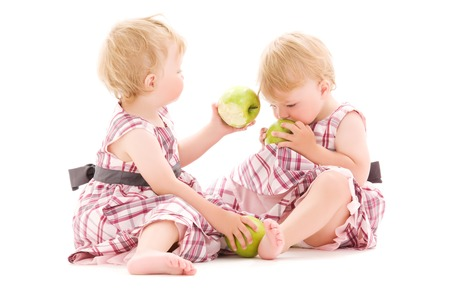 picture of two adorable twins over white Stock Photo - 5668920