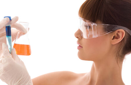 closeup of beautiful lab worker holding up test tubes Stock Photo - 5668842