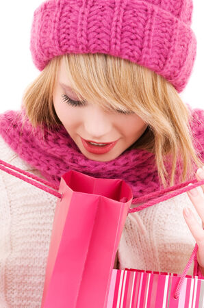 happy teenage girl in hat with pink shopping bags Stock Photo - 5668606