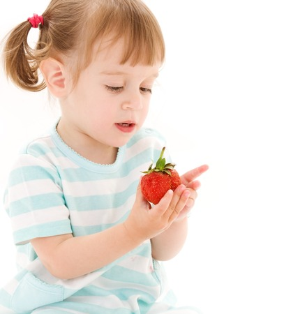 picture of little girl with strawberry over white Stock Photo - 5668671