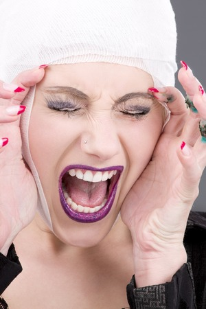 picture of screaming wounded woman face over grey Stock Photo - 5685165
