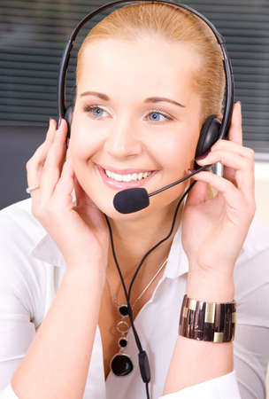 bright picture of friendly female helpline operator Stock Photo - 5685134