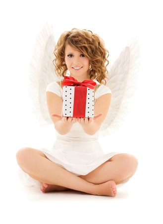 attractive angels: picture of happy teenage angel girl with gift over white LANG_EVOIMAGES