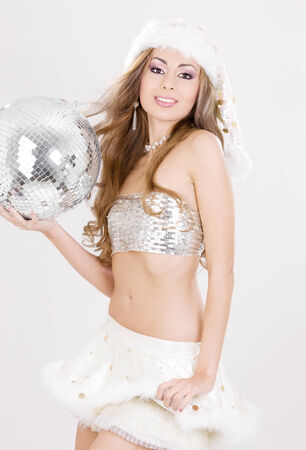 picture of sexy santa helper with disco ball Stock Photo - 5676936