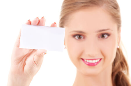 advertising woman: happy girl with business card (focus on hand) LANG_EVOIMAGES