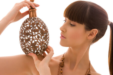 portrait of lovely woman with ancient copper jug Stock Photo - 5685063