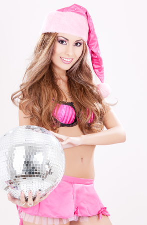 sexy santa helper in pink lingerie with disco ball Stock Photo - 5685256