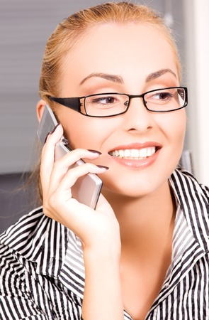 picture of lovely girl with cell phone in office Stock Photo - 5685103