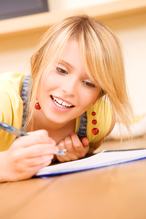 homestudy: picture of teenage girl with notebook and pen