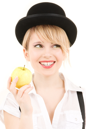 bowler: bright picture of lovely blonde with green apple