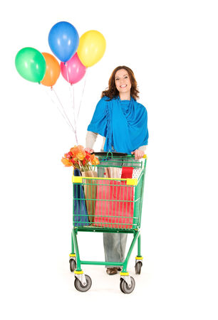 happy woman with shopping cart and balloons over white Stock Photo - 5668851