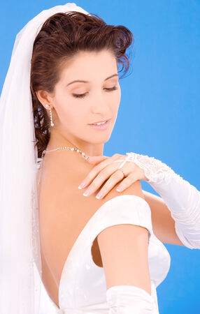 happy bride with her wedding ring over blue Stock Photo - 5685228