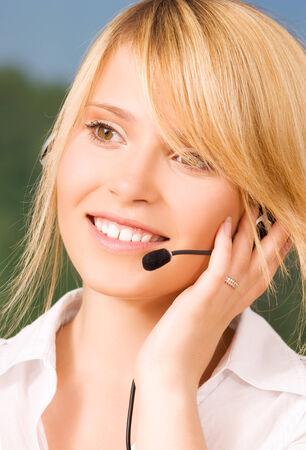 bright picture of friendly female helpline operator Stock Photo - 5685209