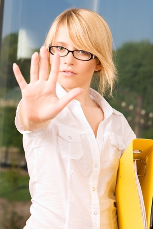 bright picture of young woman making stop gesture Stock Photo - 5668929