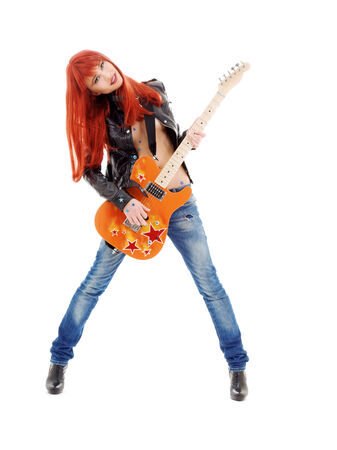 picture of lovely redhead girl with orange guitar Stock Photo - 5668774