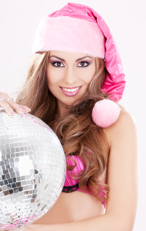 sexy santa: sexy santa helper in pink lingerie with disco ball