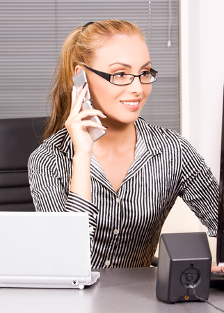 picture of lovely girl with cell phone in office Stock Photo - 5684998