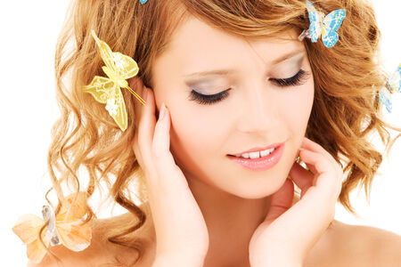 picture of teenage girl with butterflies over white Stock Photo - 5685365