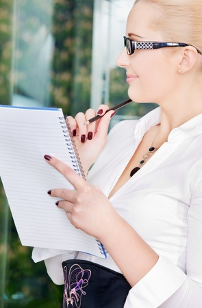bright picture of lovely businesswoman in office Stock Photo - 5684994