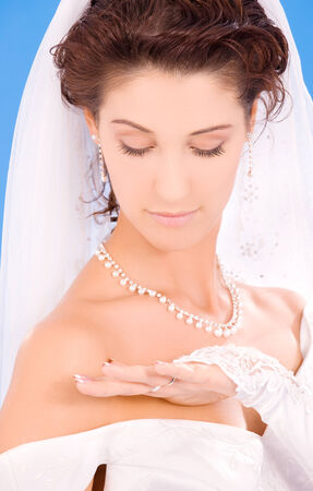 happy bride with her wedding ring over blue Stock Photo - 5685062