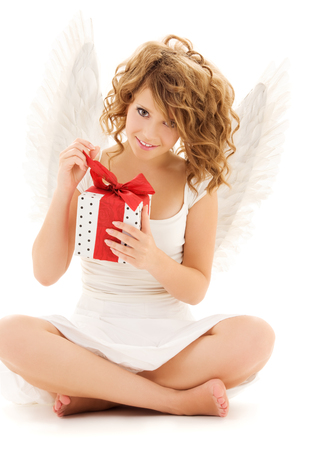 picture of happy teenage angel girl with gift over white Stock Photo - 5676906