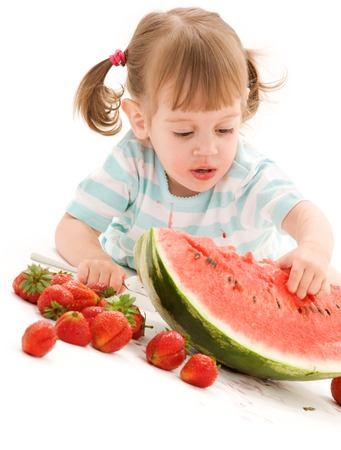 picture of little girl with strawberry and watermelon Stock Photo - 5676849