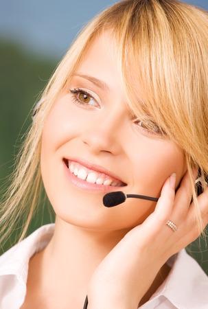 bright picture of friendly female helpline operator Stock Photo - 5685113