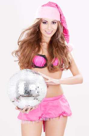sexy santa helper in pink lingerie with disco ball Stock Photo - 5685030