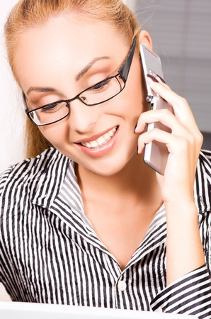 picture of lovely girl with cell phone in office Stock Photo - 5677084