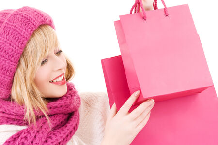 happy teenage girl in hat with pink shopping bags Stock Photo - 5668607