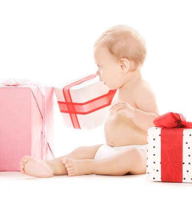 picture of baby boy with gifts over white Stock Photo - 5668785