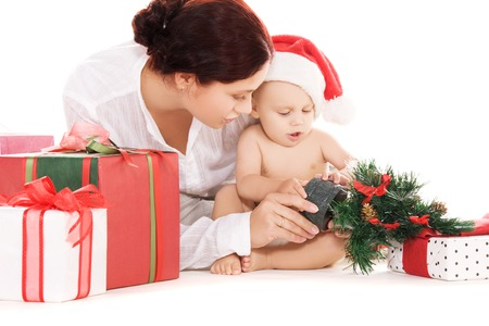 baby and mother with christmas gifts  over white (focus on baby) Stock Photo - 5677171