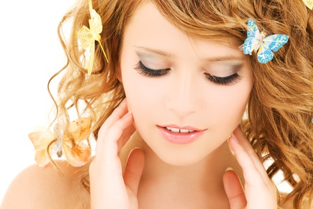 picture of teenage girl with butterflies over white Stock Photo - 5685362