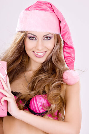 picture of cheerful santa helper girl with gift box Stock Photo - 5685327