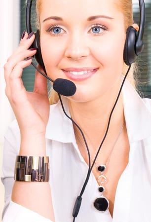 bright picture of friendly female helpline operator Stock Photo - 5668890