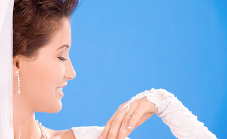happy bride with her wedding ring over blue Stock Photo - 5677156