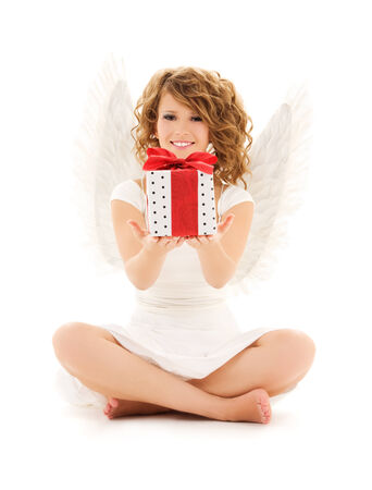 picture of happy teenage angel girl with gift over white Stock Photo - 5668881