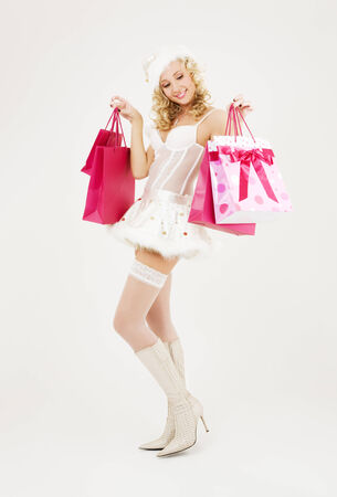 cheerful santa helper with pink shopping bags Stock Photo - 5676848