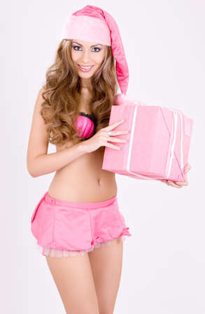 picture of cheerful santa helper girl with gift box Stock Photo - 5668973