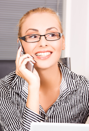 picture of lovely girl with cell phone in office Stock Photo - 5685125