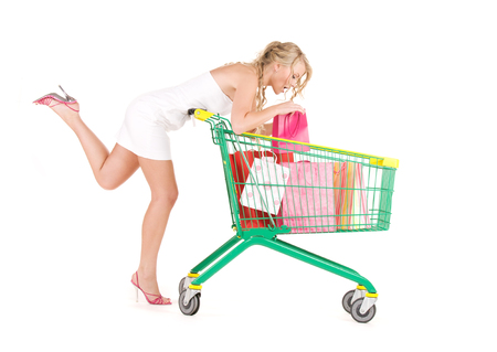 happy woman with shopping cart over white Stock Photo - 5668729