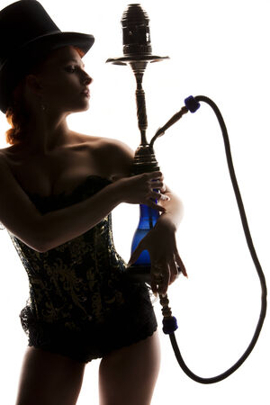 silhouette backlight picture of sexy woman with hookah Stock Photo - 5676909