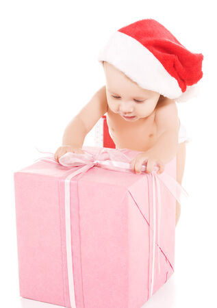 tot: santa helper baby with christmas gifts over white LANG_EVOIMAGES